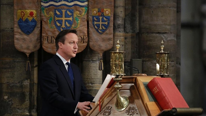 British Prime Minister David Cameron delivers a reading during a service of thanksgiving to mark the World War II, 70th anniversary of Victory in Europe (VE Day) at Westminster Abbey in London, Sunday, May 10, 2015.  (AP Photo/Matt Dunham, Pool)