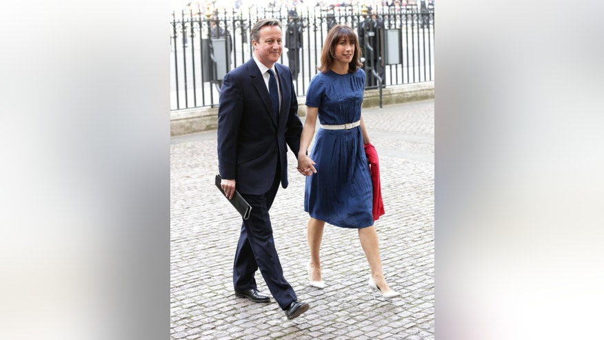 Britain's Prime Minister David Cameron and his wife Samantha arrive for a service of thanksgiving to mark the World War II, 70th anniversary of Victory in Europe (VE Day) at Westminster Abbey in London, Sunday, May 10, 2015.  (Yui Mok/PA via AP) UNITED KINGDOM OUT  NO SALES  NO ARCHIVE