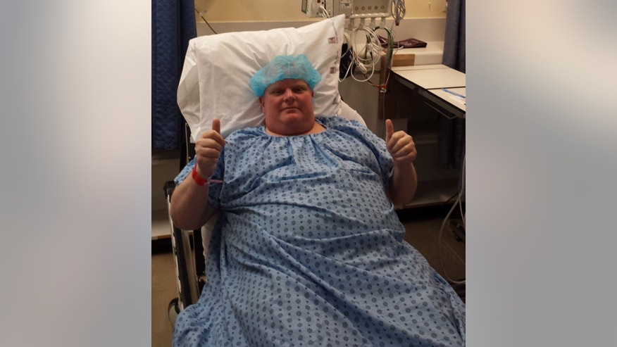 Former Toronto mayor Rob Ford gives the thumbs up sign before cancer surgery at Mount Sinai Hospital in Toronto.