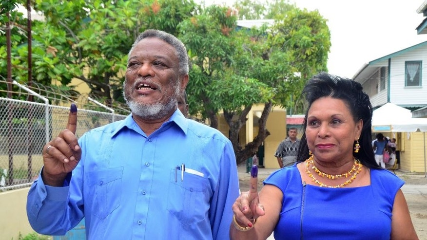 Guyana Prime Minister Samuel Hinds and his wife Yvonne show their ink-stained fingers after voting in the general elections, in Georgetown, Guyana, Monday, May 11, 2015. A party in power for over two decades in Guyana faced off in general elections Monday against a new coalition of opposition parties that seeks to challenge a tradition of racial politics and accuses the government of mismanagement and corruption. (AP Photo/Adrian Narine)
