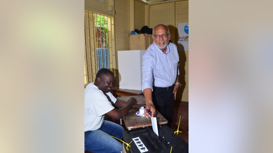 Guyana President Donald Ramotar casts his ballot in the general elections, in Georgetown, Guyana, Monday, May 11, 2015. A party in power for over two decades in Guyana faced off in general elections Monday against a new coalition of opposition parties that seeks to challenge a tradition of racial politics and accuses the Ramotar's government of mismanagement and corruption.(AP Photo/Adrian Narine)