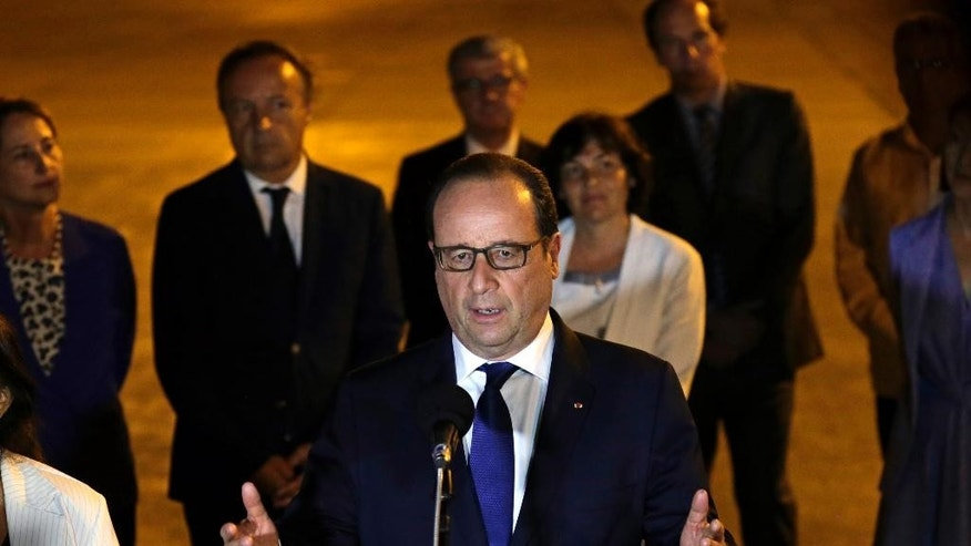 French President Francois Hollande speaks to reporters on the tarmac of Jose Marti Airport in Havana, Cuba, Sunday, May 10, 2015.  Hollande is the first French president to ever visit communist Cuba, bringing along five ministers and two dozen business people.(AP Photo/Desmond Boylan)