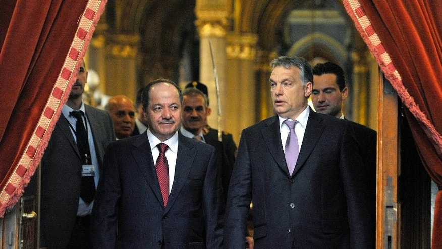 Hungarian Prime Minister Viktor Orban, right, and Masoud Barzani, president of the Iraqi self-ruled Kurdish region, arrive for a news conference after their talks at the parliament in Budapest, Hungary, Monday, May 11, 2015. (Tamas Kovacs/MTI via AP)