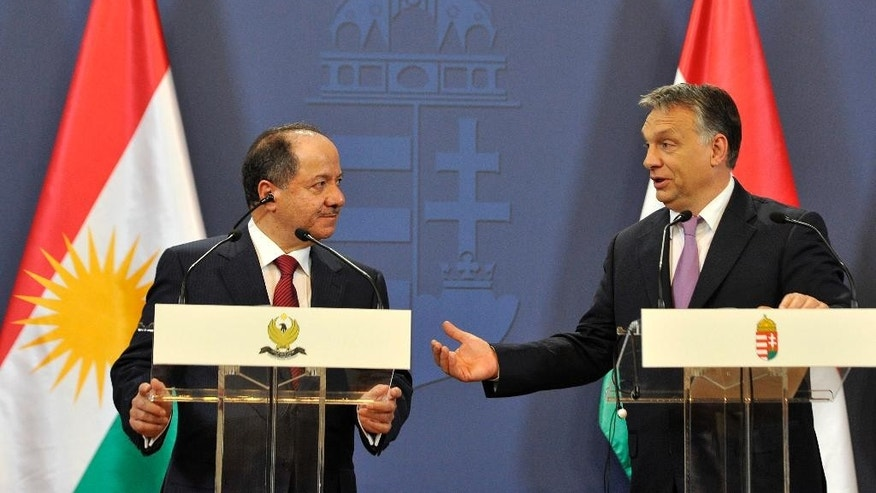 Hungarian Prime Minister Viktor Orban, right, and Masoud Barzani, president of the Iraqi self-ruled Kurdish region, address the media during a news conference after their talks at the parliament in Budapest, Hungary, Monday, May 11, 2015. (Tamas Kovacs/MTI via AP)