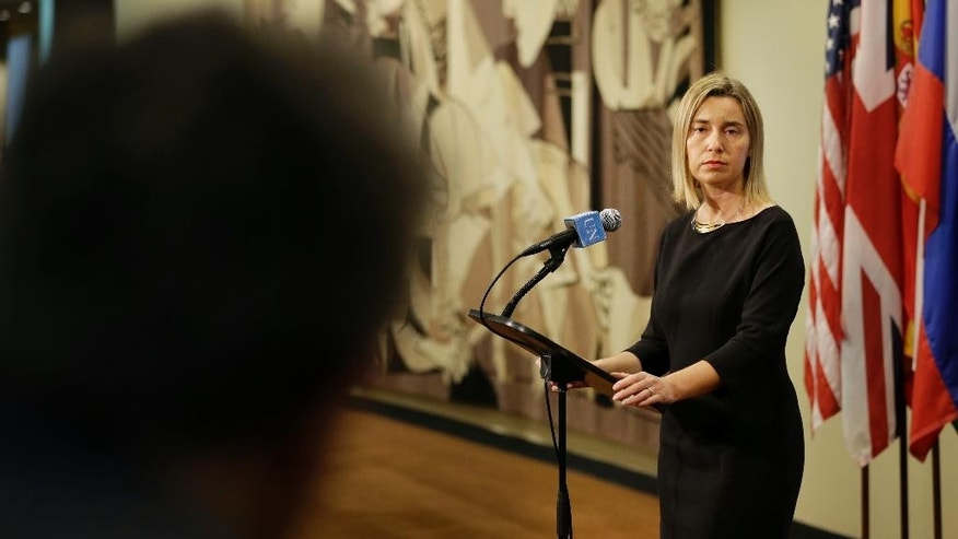 "Federica Mogherini, the high representative of the European Union for foreign affairs, speaks to reporters after a security council meeting at United Nations headquarters, Monday, May 11, 2015. The European Union's top diplomat has assured the U.N. Security Council that under a proposed EU maritime operation against the growing wave of migrant smuggling, ""no refugee or migrant intercepted at sea will be sent back against their will."" (AP Photo/Seth Wenig)"