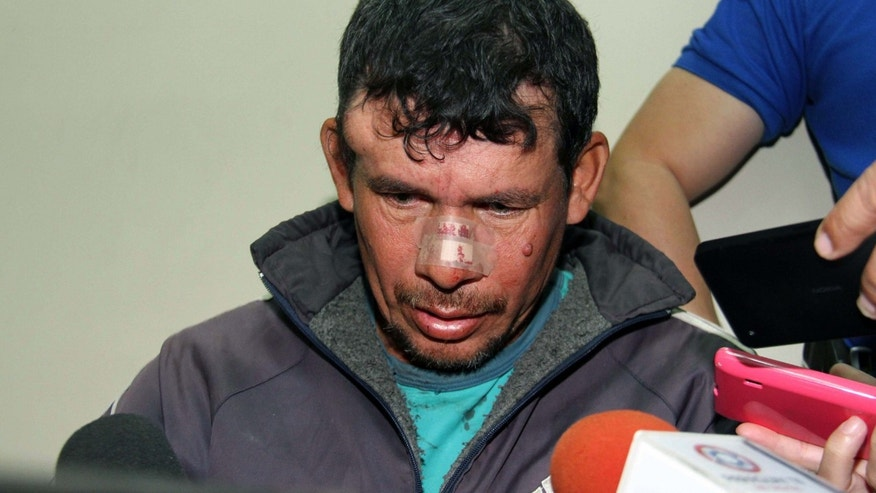 Gilberto Benitez Zarate hounded by the press after being arrested on May 9, 2015 in Asuncion.