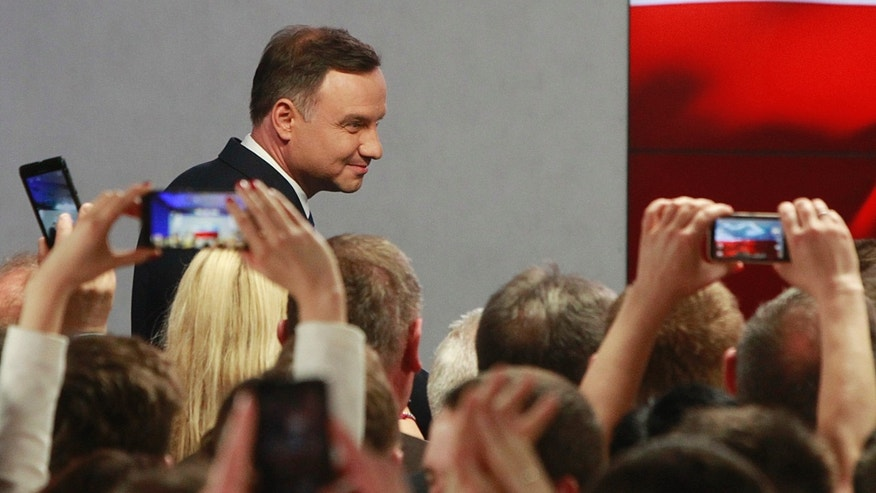 May 10, 2015 - Main opposition candidate Andrzej Duda greets supporters during his election night as first exit polls show he won the first round of the presidential balloting, in Warsaw, Poland.