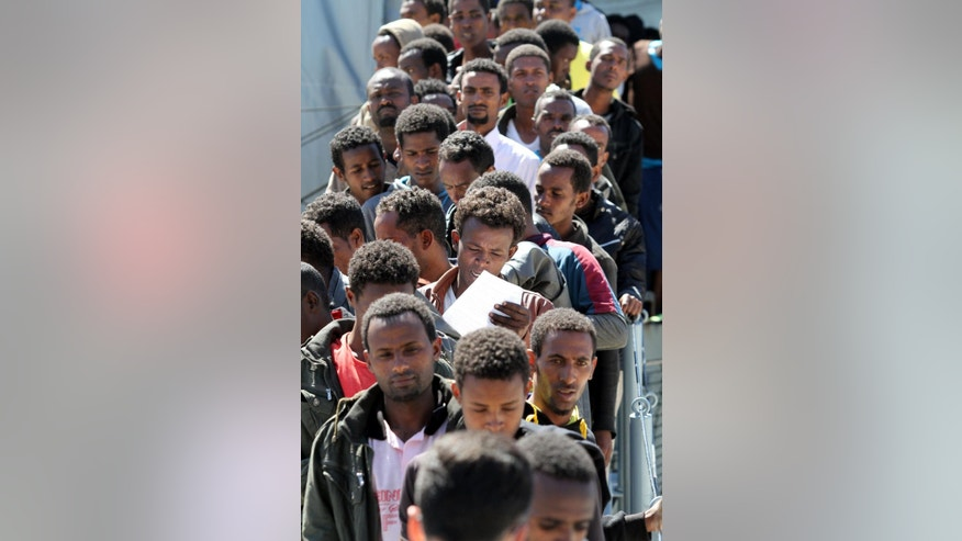 Migrants disembark from the German Navy ship Hessen, at the Reggio Calabria harbor, southern Italy, Saturday, May 9, 2015. Ireland and France are the latest European Union nations answering Italy's pleas for help with the rescue of migrants' who are risking their lives on smugglers' boats in the Mediterranean. Two German ships and a British vessel are already pitching in, after Italy appealed for help with the migrants, who arrive daily by the hundreds or by the thousands on overcrowded, unseaworthy fishing boats and dinghies setting sail from Libya, where the smugglers are based. (AP Photo/Adriana Sapone)