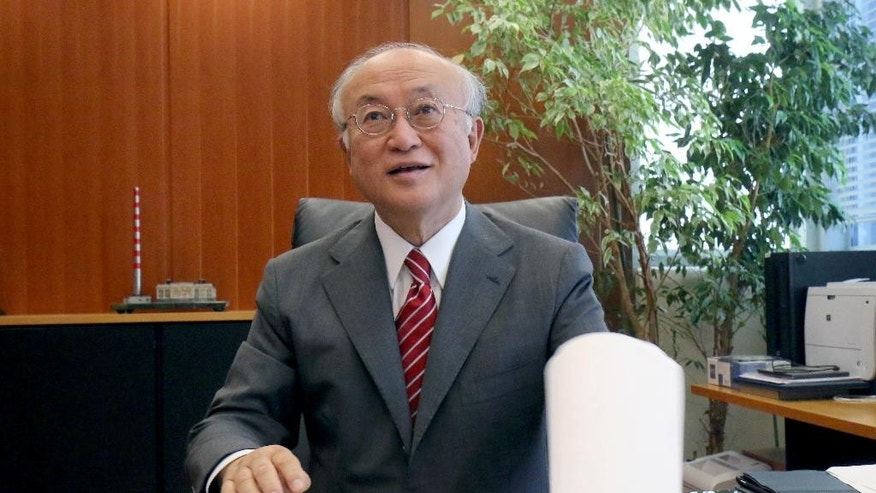 Director General of the International Atomic Energy Agency, IAEA, Yukiya Amano from Japan speaks during an interview with the Associated Press in Vienna, Austria, Tuesday, May 12, 2015. Amano said setting up a potential showdown with Iran, that his experts will have the right to push for access to Iranian military sites under an envisaged nuclear agreement between Tehran and six world powers. (AP Photo/Ronald Zak)
