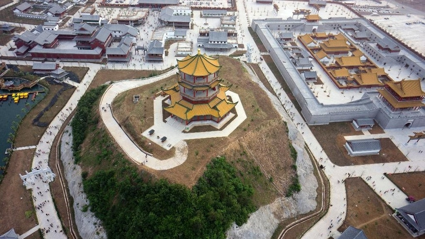 This photo taken Saturday May 9, 2015, shows an aerial view of the New Yuanmingyuan, a newly-built replica of Beijing's Old Summer Palace which was looted and destroyed by French and British forces in 1860, in Hengdian township of Dongyang city in east China's Zhejiang province. Hengdian Studios built the 30 billion yuan ($5 billion) film set of what it says the 3.5 square kilometer (1.35 sq. mile) palace grounds in Beijing looked like before they were razed and left in ruins by foreign forces more than 150 years ago.(Chinatopix Via AP) CHINA OUT