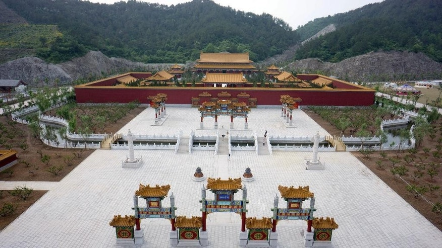 This photo taken May 9, 2015, shows an aerial view of the New Yuanmingyuan, a newly-built replica of Beijing's Old Summer Palace which was looted and destroyed by French and British forces in 1860, in Hengdian township of Dongyang city in east China's Zhejiang province. Hengdian Studios built the 30 billion yuan ($5 billion) film set of what it says the 3.5 square kilometer (1.35 sq. mile) palace grounds in Beijing looked like before they were razed and left in ruins by foreign forces more than 150 years ago.(Chinatopix Via AP) CHINA OUT
