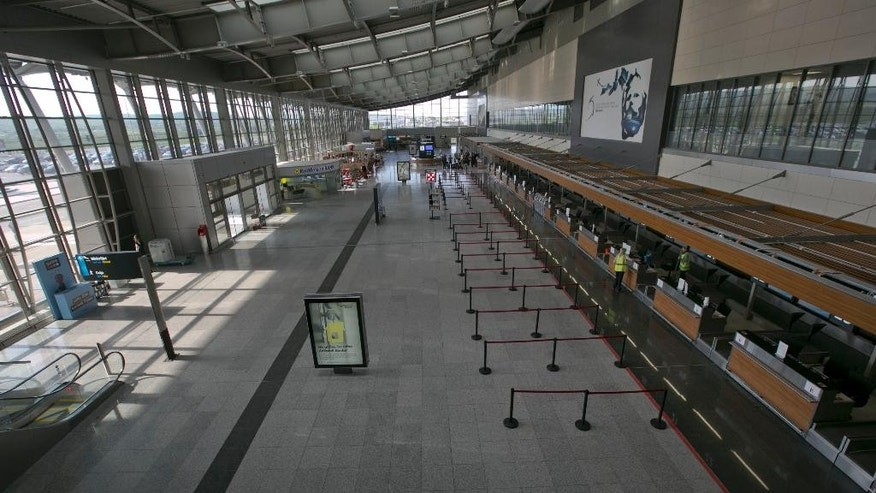 Empty departures hall seen at Pristina main airport as flights are canceled after a helicopter belonging to a European Union mission in Kosovo crashed at the country's main airport, injuring one member of the mission, Kosovo airport spokeswoman Valentina Gara said in Slatina, Kosovo, Tuesday May 12, 2015. The mission, known as EULEX helps Kosovo authorities fight organized crime, corruption and war crimes committed during the 1998-99 Kosovo war.  (AP Photo/Visar Kryeziu)