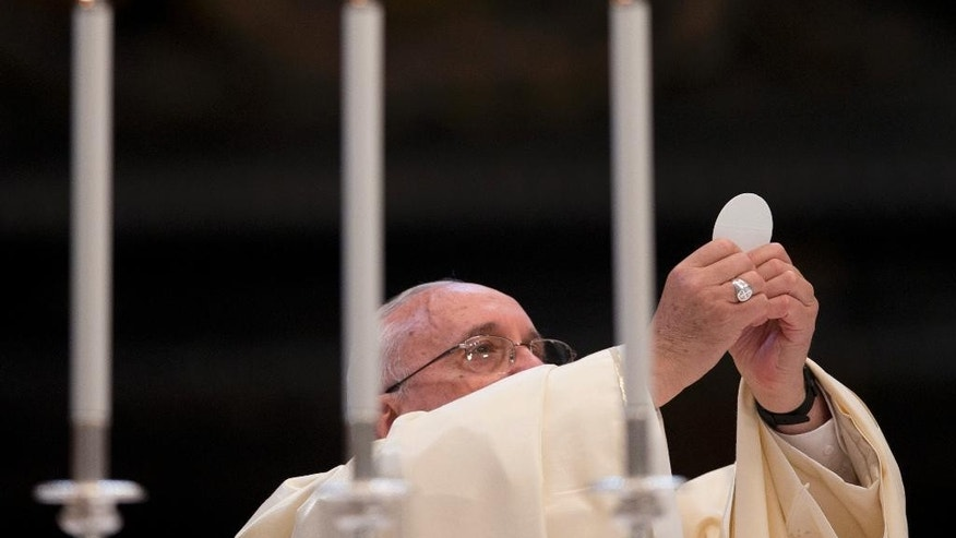 Pope Francis celebrates a Mass in St. Peter's Basilica at the Vatican on the occasion on the opening of the Caritas Internationalis general Assembly, Tuesday, May 12, 2015. (AP Photo/Alessandra Tarantino)