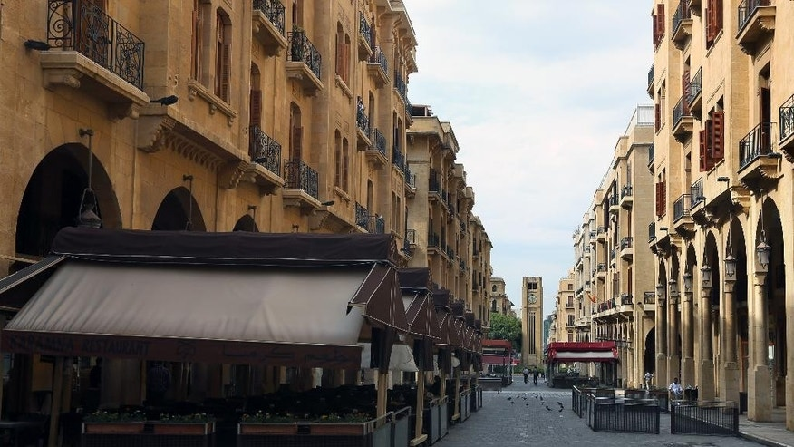 Empty restaurants and cafes are seen at the Parliament square, in downtown Beirut, Lebanon, Wednesday, May 13, 2015. Not even tourists can set foot anywhere in the area during the twice-monthly lockdowns as lawmakers meet. On Wednesday, for the twenty-third time in a row, they failed to elect a president. (AP Photo/Bilal Hussein)