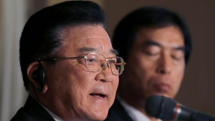 "Kampei Shimoide, left, mayor of Minamikyushu, speaks during a press conference at the Foreign Correspondents' Club of Japan in Tokyo, Wednesday, May 13, 2015. The Japanese city's plan to seek UNESCO recognition for its collection of documents related to its role as a launching base for ""kamikaze"" suicide attacks in the desperate last months of World War II is raising questions over how such memories should be preserved. Shimoide and others associated with the project said Wednesday they hope that registering the document collection as a UNESCO ""Memory of the World"" will help ensure it will convey the horrors and suffering of the war to future generations. (AP Photo/Shizuo Kambayashi)"