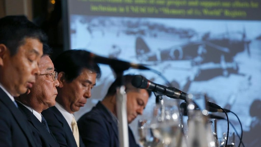 "Kampei Shimoide, second from left, mayor of Minamikyushu listens to a reporter's questions during a press conference at the Foreign Correspondents' Club of Japan in Tokyo, Wednesday, May 13, 2015. The Japanese city's plan to seek UNESCO recognition for its collection of documents related to its role as a launching base for ""kamikaze"" suicide attacks in the desperate last months of World War II is raising questions over how such memories should be preserved. Shimoide and others associated with the project said Wednesday they hope that registering the document collection as a UNESCO ""Memory of the World"" will help ensure it will convey the horrors and suffering of the war to future generations. (AP Photo/Shizuo Kambayashi)"