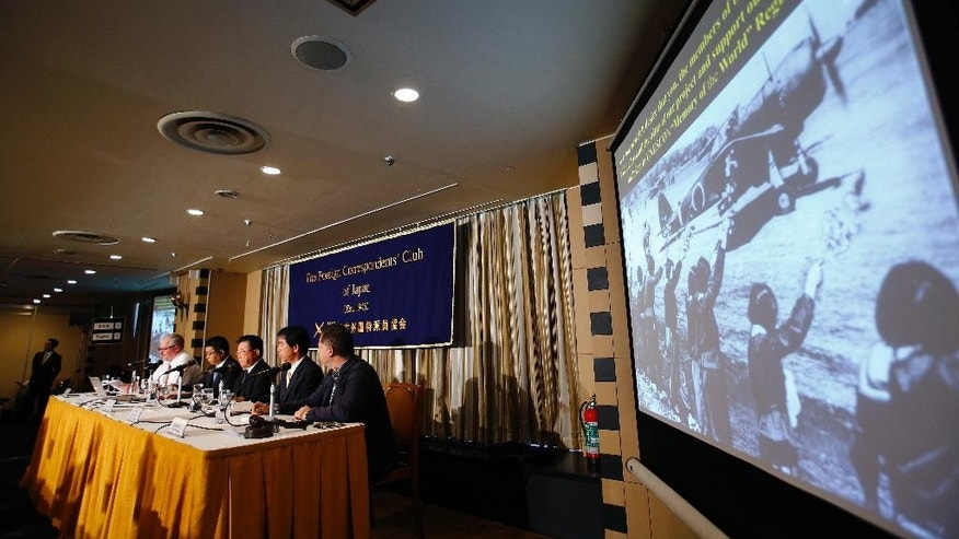 "Kampei Shimoide, third from left, mayor of Minamikyushu, listens to a reporter's questions during a press conference at the Foreign Correspondents' Club of Japan in Tokyo, Wednesday, May 13, 2015. The Japanese city's plan to seek UNESCO recognition for its collection of documents related to its role as a launching base for ""kamikaze"" suicide attacks in the desperate last months of World War II is raising questions over how such memories should be preserved. Shimoide and others associated with the project said Wednesday they hope that registering the document collection as a UNESCO ""Memory of the World"" will help ensure it will convey the horrors and suffering of the war to future generations. (AP Photo/Shizuo Kambayashi)"
