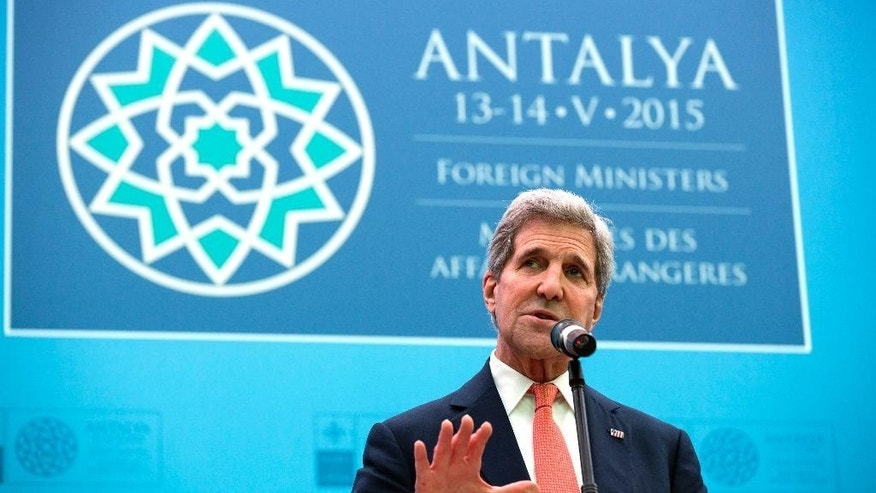 U.S. Secretary of State John Kerry speaks at the NATO foreign ministers meeting in Antalya, Turkey, Wednesday, May 13, 2015. A day after lengthy talks with Russian President Vladimir Putin, Kerry was filling in allies during a gathering of NATO foreign ministers in the southern Turkish town of Antalya. (Joshua Roberts/Pool Photo via AP)