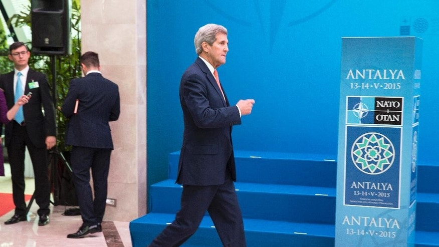 U.S. Secretary of State John Kerry arrives to speak at the NATO foreign ministers meeting in Antalya, Turkey, Wednesday, May 13, 2015. A day after lengthy talks with Russian President Vladimir Putin, Kerry was filling in allies during a gathering of NATO foreign ministers in the southern Turkish town of Antalya. (Joshua Roberts/Pool Photo via AP)