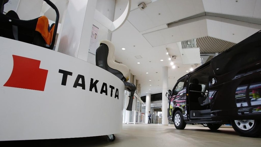 FILE - In this Nov. 6, 2014 file photo, child seats manufactured by Takata Corp. are displayed at a Toyota Motor Corp.'s showroom in Tokyo. Toyota and Nissan Motor Co. are expanding their recalls over problem air bags made by Japanese supplier Takata Corp. Toyota said Wednesday, May 13, 2015, it was recalling nearly 5 million more vehicles globally for the air bag inflator problem. Some 637,000 of them in the United States. In Japan, it is recalling nearly 1.4 million vehicles. (AP Photo/Shizuo Kambayashi, File)