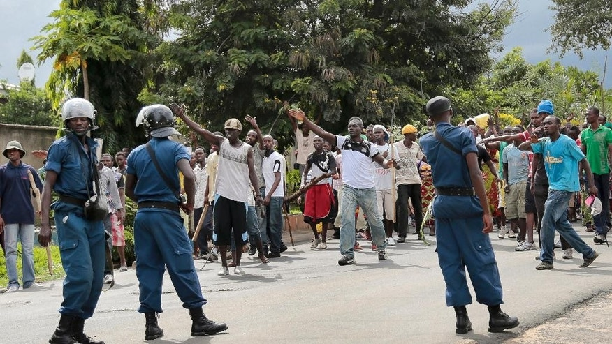 May 13, 2015: Demonstrators trying to march to the town center confront police, before they were dispersed with tear gas, in the Ngagara district of Bujumbura, Burundi.