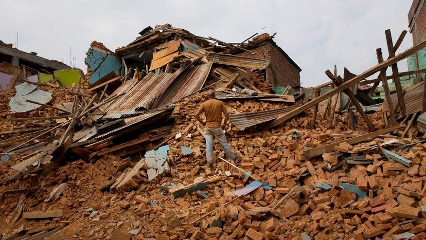 May 13, 2015: A man inspects an area that collapsed during the May 12 earthquake in Chautara, Nepal.