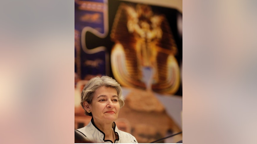"UNESCO Director-General Irina Bokova of Bulgaria attends the opening of  a conference titled,  ""Cultural Property under Threat,"" in Cairo, Egypt, Wednesday, May 13, 2015. Bokova said the destruction and looting of archaeological sites in the Middle East must be condemned as a ""war crime."" The two-day conference is being held in response to the destruction of ancient temples and artifacts in Iraq by the extremist Islamic State group as well as the looting and smuggling of antiquities in Iraq, Syria, Egypt and Libya. (AP Photo/Amr Nabil)"