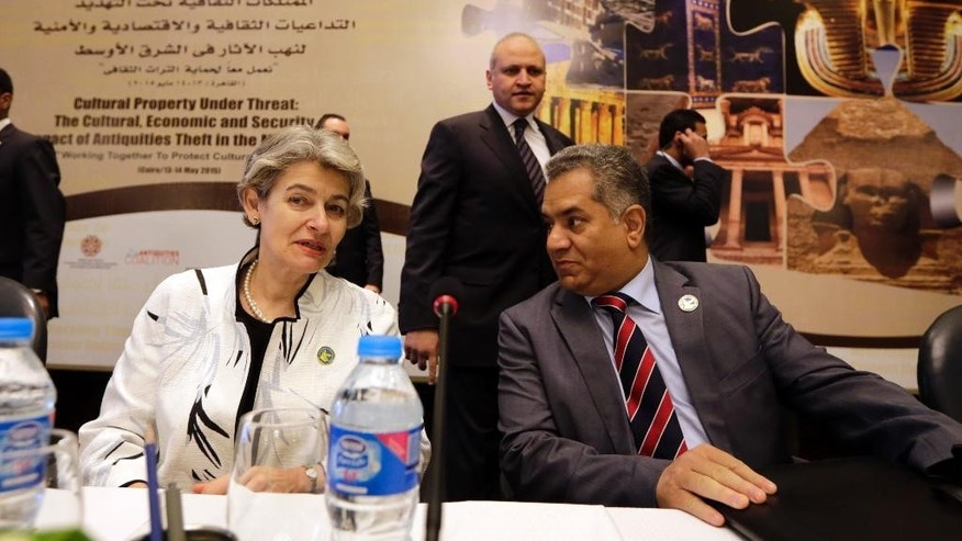 "UNESCO Director-General Irina Bokova of Bulgaria and Egyptian Antiquities Minister Mamdouh el-Damaty, attend the opening of  a conference titled,  ""Cultural Property Under Threat,"" in Cairo, Egypt, Wednesday, May 13, 2015. Bokova said the destruction and looting of archaeological sites in the Middle East must be condemned as a ""war crime."" The two-day conference is being held in response to the destruction of ancient temples and artifacts in Iraq by the extremist Islamic State group as well as the looting and smuggling of antiquities in Iraq, Syria, Egypt and Libya. (AP Photo/Amr Nabil)"