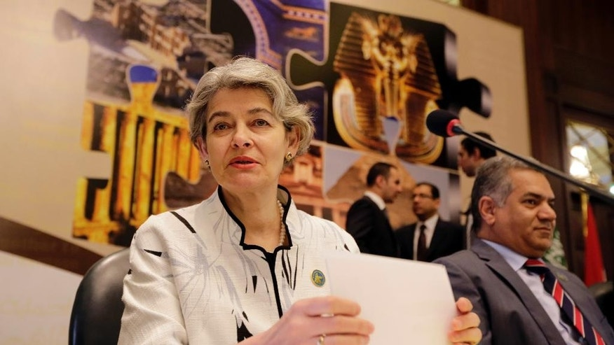 "UNESCO Director-General Irina Bokova of Bulgaria and Egyptian Antiquities Minister Mamdouh el-Damaty, attend the opening of  a conference on ""cultural property under threat."", in Cairo, Egypt, Wednesday, May 13, 2015. Bokova said the destruction and looting of archaeological sites in the Middle East must be condemned as a ""war crime."" The two-day conference is being held in response to the destruction of ancient temples and artifacts in Iraq by the extremist Islamic State group as well as the looting and smuggling of antiquities in Iraq, Syria, Egypt and Libya. (AP Photo/Amr Nabil)"