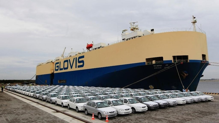 "FILE- In this June 6, 2012 file photo, Hyundai cars manufactured in India are parked after being unloaded from the carrier ship Asian Sun at the Chinese built port in Hambantota, Sri Lanka. India is deeply unsettled over China's growing presence in the Indian Ocean, a scenario some analysts call the ""string of pearls"" strategy linking China's interests in the countries surrounding India. China began by building the port at Hambantota and significantly upped the stakes with a massive development project off the coast of the capital, Colombo. ( AP Photo/Chamila Karunarathne, file)"