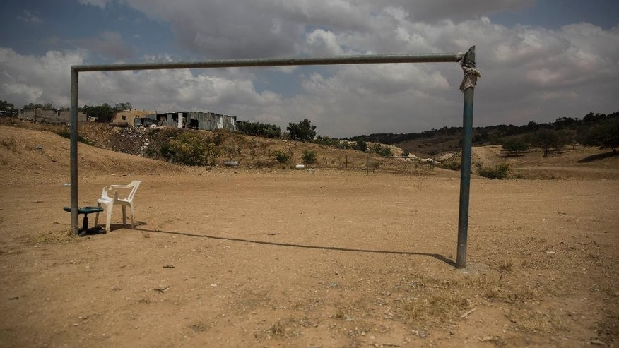 """This Tuesday, May 12, 2015 photo shows a playground in the village of Umm Al-Hiran in the Negev desert, Israel. In a landmark decision, Israel's Supreme Court has cleared the way for the government to uproot the nearly 60-year-old Bedouin Arab village of Umm al-Hiran, a dusty hill of ramshackle dwellings without proper electricity or water hookups, and in its place build """"Hiran,"""" a new Jewish community expected to feature a hotel and country club. (AP Photo/Tsafrir Abayov)"""