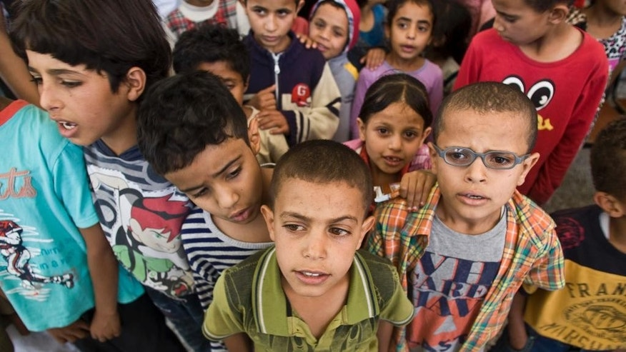 Displaced boys who fled their home after a Saudi-led airstrike destroyed their houses, live in a school in Sanaa, Yemen, Thursday, May 14, 2015. The conflict in Yemen has killed more than 1,400 people — many of them civilians — since March 19, according to the U.N. The country of some 25 million people has endured shortages of food, water, medicine and electricity as a result of a Saudi-led blockade. (AP Photo/Hani Mohammed)