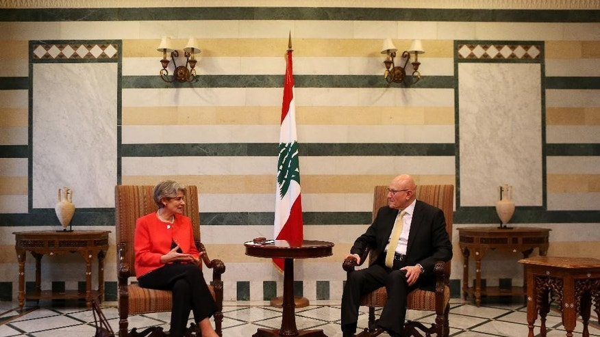 The chief of the U.N.'s education and culture agency, Irina Bokova of Bulgaria, left, meets with Lebanese Prime Minister Tammam Salam, right, at the government palace in Beirut, Lebanon, Friday, May 15, 2015. Bokova is in Lebanon to meet with Lebanese senior officials and students, and pledge UNESCO's support to the country's efforts to respond to the regional crisis and foster cultural diversity. (AP Photo/Hussein Malla)