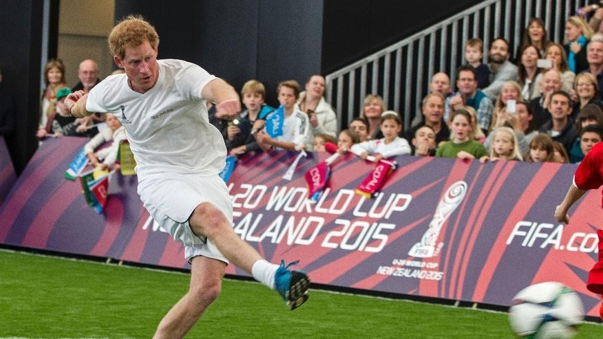 Britain's Prince Harry kicks the ball during a 5-a-side football game at The Cloud, a multi-purpose venue in Auckland, New Zealand, Saturday, May 16, 2015. Prince Harry is on the last day of his visit to New Zealand. (Michael Craig/Herald on Sunday via AP) NEW ZEALAND OUT, AUSTRALIA OUT