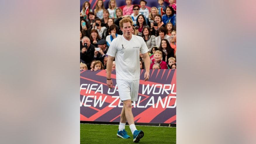Britain's Prince Harry catches his breathe during a 5-a-side football game at The Cloud, a multi-purpose venue in Auckland, New Zealand, Saturday, May 16, 2015. Prince Harry is on the last day of his visit to New Zealand. (Michael Craig/Herald on Sunday via AP) NEW ZEALAND OUT, AUSTRALIA OUT