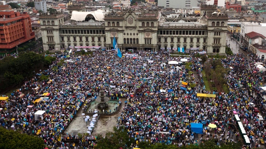 May 16, 2015: Protesters gather outside the National Palace to demand the resignation of Guatemalan President Otto Perez Molina in Guatemala City.