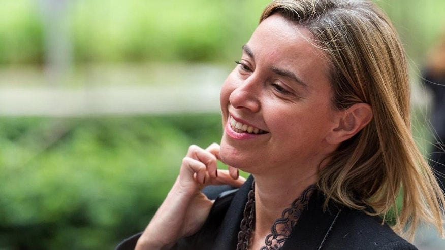 European Union High Representative Federica Mogherini smiles as she arrives for a meeting of EU defense ministers at the European Council building in Brussels on Monday May 18, 2015. (AP Photo/Geert Vanden Wijngaert)