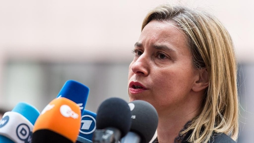 European Union High Representative Federica Mogherini talks with journalists as she arrives for a meeting of EU defense ministers at the European Council building in Brussels on Monday May 18, 2015. (AP Photo/Geert Vanden Wijngaert)