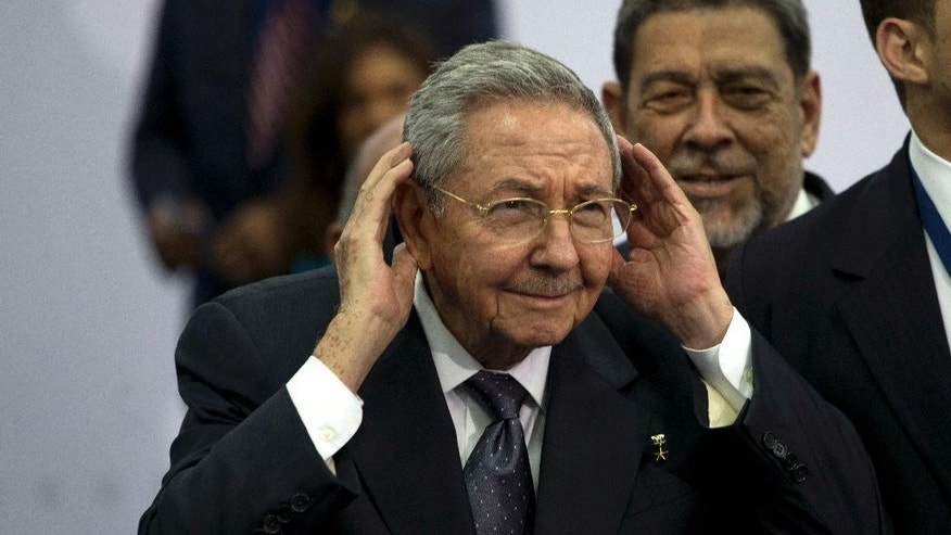 FILE - In this Saturday, April 11, 2015, file photo, Cuba's President Raul Castro cups his ears to better hear a question shouted out at him during the official group photo of the VII Summit of the Americas, in Panama City, Panama. Castro in December 2014, agreed to talks with the U.S. aimed at normalizing relations, a move expected to fuel growth in the beleaguered communist-run economy. (AP Photo/Moises Castillo, File)