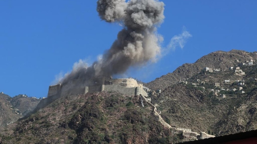 Smoke rises from al-Qahira castle, an ancient fortress that was recently taken over by Shiite rebels, following a Saudi-led airstrike in Taiz city, Yemen, Tuesday, May 12, 2015. Warplanes from a Saudi-led coalition kept up their airstrikes in Yemen on Tuesday, targeting the positions of Shiite rebels and their allies just hours ahead of the scheduled start of a five-day humanitarian cease-fire.  (AP Photo/Abdulnasser Alseddik)