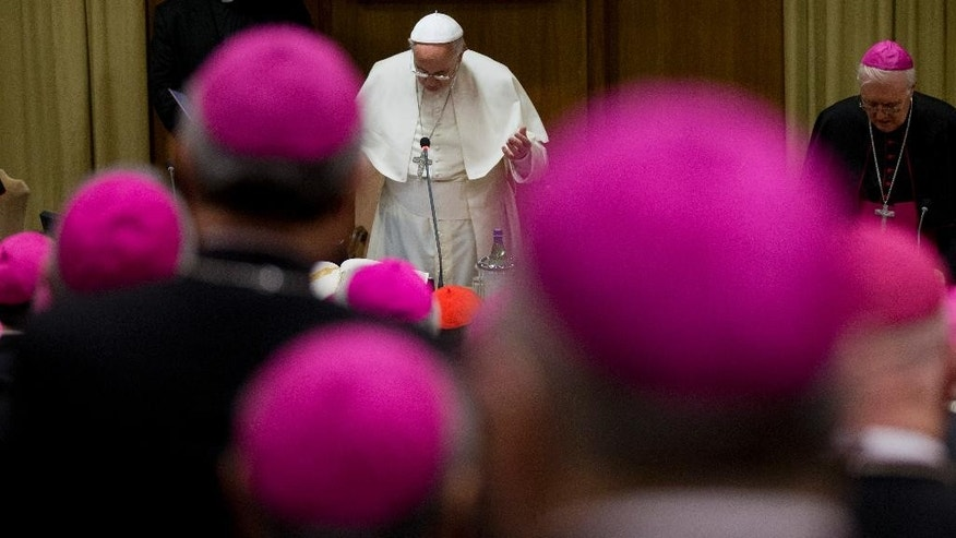 Pope Francis prays during the opening session of a Italian Episcopal Conference meeting, at the Vatican, Monday, May 18, 2015. (AP Photo/Alessandra Tarantino)