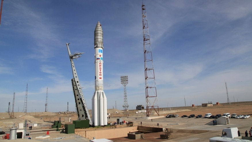 In this photo taken Thursday, April 24, 2014, a Proton-M rocket is installed at launched Baikonur launch pad in Kazakhstan.  A Russian rocket, Proton-M, carrying a Mexican satellite malfunctioned Saturday May 16, 2015, shortly after its launch, the latest mishap to hit Russia's troubled space industry, whose Soviet-era glory has been tarnished by a series of launch failures. (Roscosmos via AP)
