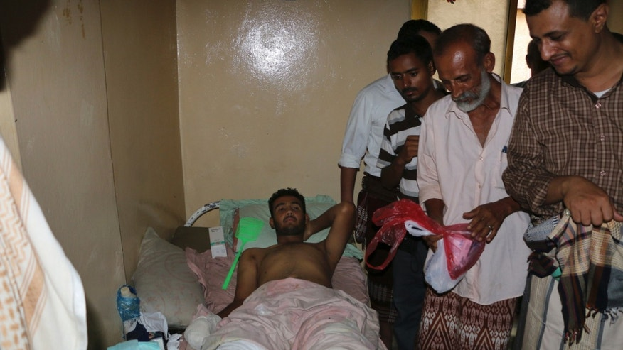 May 6, 2015 - A man injured during clashes between tribal fighters who support the Saudi-led campaign and Shiite rebels, at his home in Taiz, Yemen. Saudi-led coalition airstrikes targeting Yemen's Shiite rebels resumed early Monday in the southern port city of Aden after a 5-day truce.