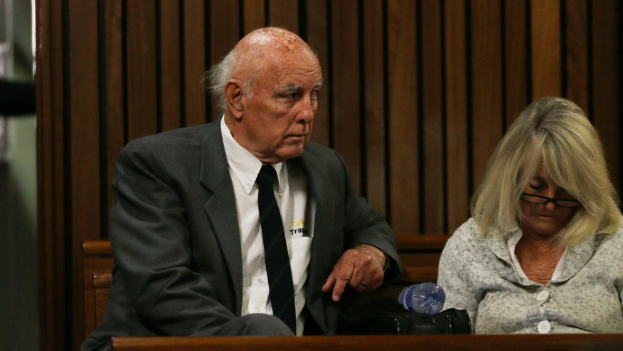 May 18, 2015 - Retired tennis player Bob Hewitt with his wife, Delaille Hewitt, ahead of his sentencing at the high court in Pretoria, South Africa.  Hewitt, a former Grand Slam doubles tennis champion, was convicted in South African court of rape and sexual assault decades after the alleged assaults, and sentenced to 6 years in prison.