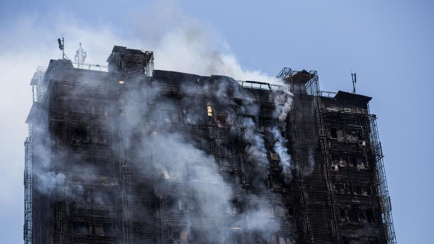 An apartment building on fire is seen in Baku, Azerbaijan, Tuesday, May 19, 2015. Azerbaijani officials say 16 people have died and more than 50 have been injured in a fire at an apartment building in Baku, the capital. The massive fire quickly engulfed 16-story apartment building Tuesday and took hours to contain. Azerbaijan's chief prosecutor, Zakir Garalov, said the bad quality of plastic paneling covering the building contributed to the fire and a criminal probe has been launched to determine the culprits. (AP Photo/Orxan Azim)