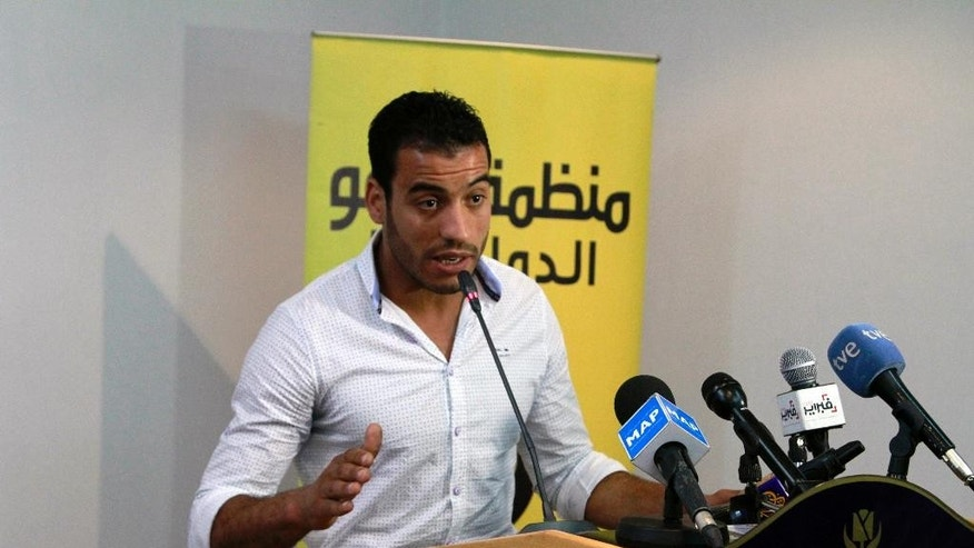 Abderrazak Jkaou describes to reporters how he was tortured and beaten by police for demonstrating, in Rabat, Morocco, Tuesday, May 19, 2015. Human rights group Amnesty International has issued a report documenting widespread torture by the Moroccan state, contrary to its public commitment to reform. The report recommended that lawyers be present during interrogations, allegations of torture be investigated and those reporting abuses be protected -- all measures present in the penal code but rarely implemented. (AP Photo/Paul Schemm)