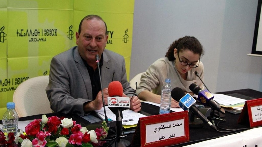 Amnesty International director Mohammed Sektaoui, left, addresses reporters at a press conference next to Amnesty researcher Sirine Rached, in Rabat, Morocco, Tuesday, May 19, 2015. Human rights group Amnesty International has issued a report documenting widespread torture by the Moroccan state, contrary to its public commitment to reform. The report recommended that lawyers be present during interrogations, allegations of torture be investigated and those reporting abuses be protected -- all measures present in the penal code but rarely implemented. (AP Photo/Paul Schemm)