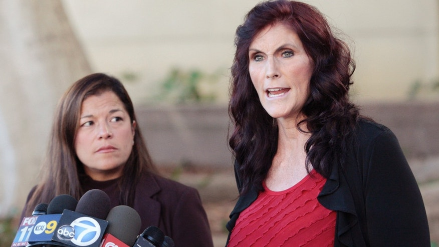 "FILE - In this Thursday, Sept. 20, 2012, file photo, Cindy Lee Garcia, one of the actresses in ""Innocence of Muslims,"" right, and attorney M. Cris Armenta hold a news conference in Los Angeles asking a judge to issue an injunction demanding a 14-minute trailer for the film be pulled from YouTube. A federal appeals court on Monday, May 18, 2015 overturned an order for YouTube to take down the anti-Muslim film that sparked violence in the Middle East and death threats to actors. (AP Photo/Jason Redmond, File)"