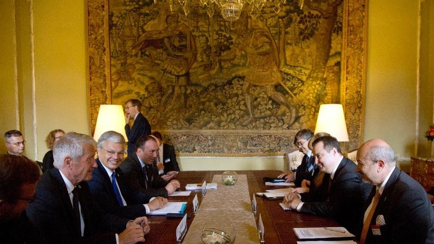 Secretary General of the Council of Europe Thorbjorn Jagland, left, and Belgian Foreign Minister Didier Reynders, second left, meet with Serbia's Foreign Minister Ivica Dacic, second right, during a meeting of the Council of Europe in Brussels Tuesday, May 19, 2015. The Council of Europe meets Tuesday with ministers of state to discuss terrorism. (AP Photo/Virginia Mayo)