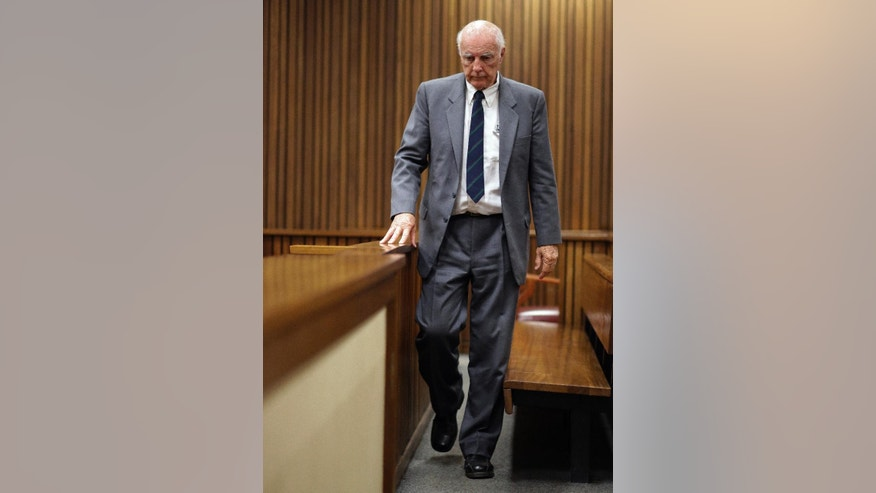 Retired tennis player Bob Hewitt walks into the dock before the start of his appeal at the high court in Pretoria, South Africa Tuesday, May 19, 2015. Judge Bert Bam on Monday sentenced Hewitt to eight years in jail for two counts of rape, with two years suspended. He also sentenced Hewitt to two years in prison for a third charge of sexual assault. (AP Photo/Themba Hadebe)